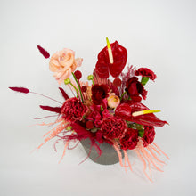 Load image into Gallery viewer, fresh red floral arrangement in gray vase