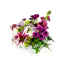 Load image into Gallery viewer, Purple, lavender, and white flowers sit in a delicate vase against a white background