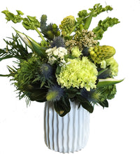Load image into Gallery viewer, Bells of Ireland arrangement in a decorative vase