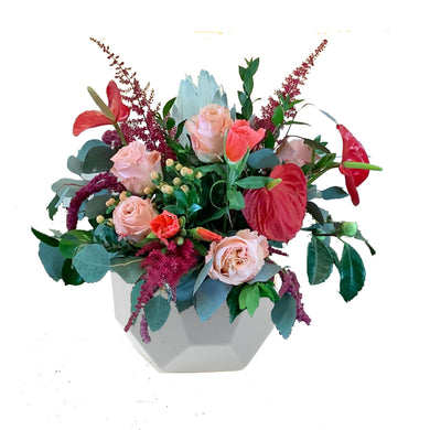 Bright floral mix of Anthurium, Roses, Eucalyptus, and Amaranthus in a modern, ceramic bowl