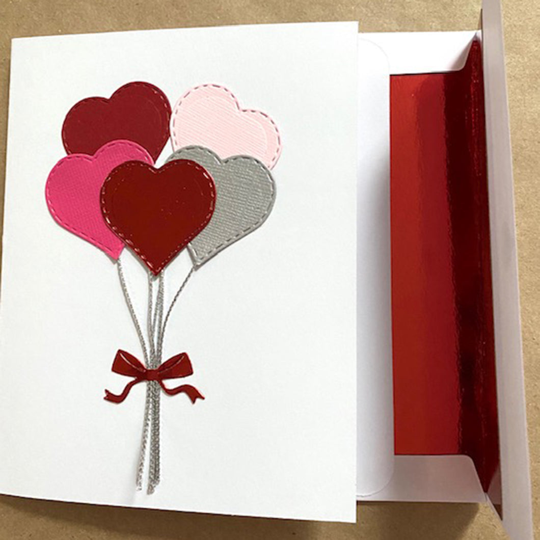 red and pink heart balloons greeting card