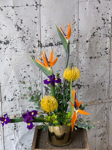 Orange, yellow, purple tropical summer floral arrangment