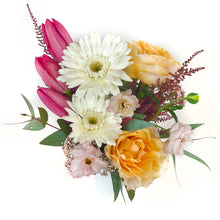 Load image into Gallery viewer, A white vase holds soft orange, purple, white, and pink flowers against a white background