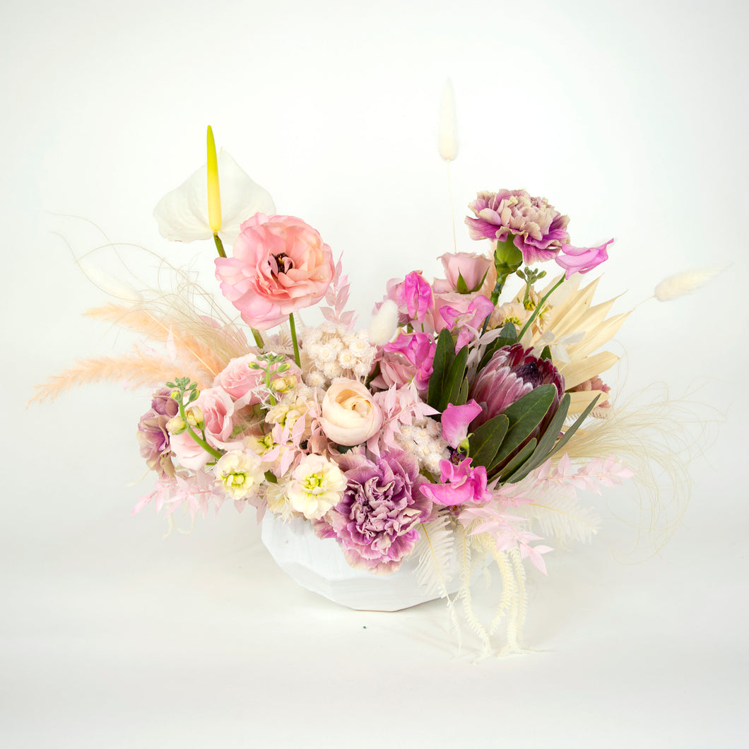 fresh pink and neutral floral arrangement in white vase
