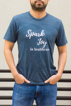 Load image into Gallery viewer, Spark Joy in Healthcare Tee T-shirts community, mentorship and coaching for pharmacists and healthcare professionals. Bring JOY back into healthcare. Pharmacist gift. Healthcare gift. Medicine gift. Nursing student gift.