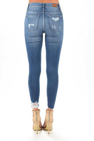 Medium Wash Heavily Destructed Skinny Jeans