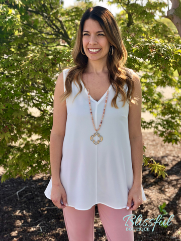 Ivory Sleeveless V-Neck Tunic Top
