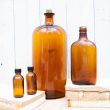 Load image into Gallery viewer, Vintage Amber Bottles