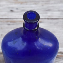 Load image into Gallery viewer, Vintage Cobalt Glass Bottle