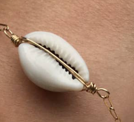 Delicate cowrie shell bracelet  is created with gold fill link box chain, hand wired and secured with a lobster clasp for durability.
