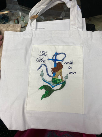 White Cotton Mermaid Sitting on Anchor Beach Bag by Marianne Bramble