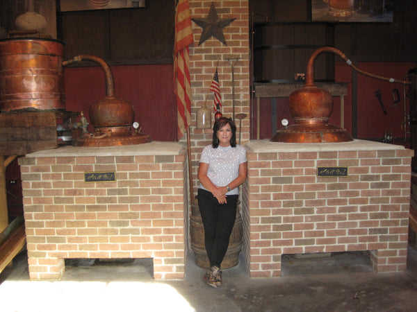 Missy standing in front of the stills