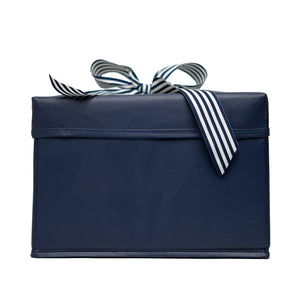 Small Shoebox-Sized Blue Collapsible Gift Box with ribbon attached, great zero waste solution for sustainable and eco-friendly gift boxes - EverWrap