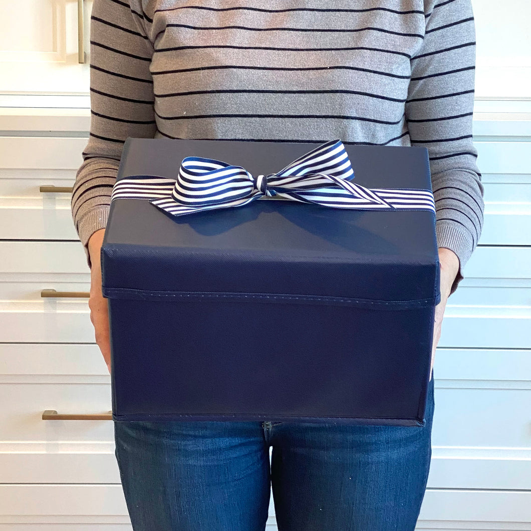 Small Shoebox-Sized Blue Collapsible Gift Box with ribbon attached, great zero waste solution for sustainable and eco-friendly gift boxes