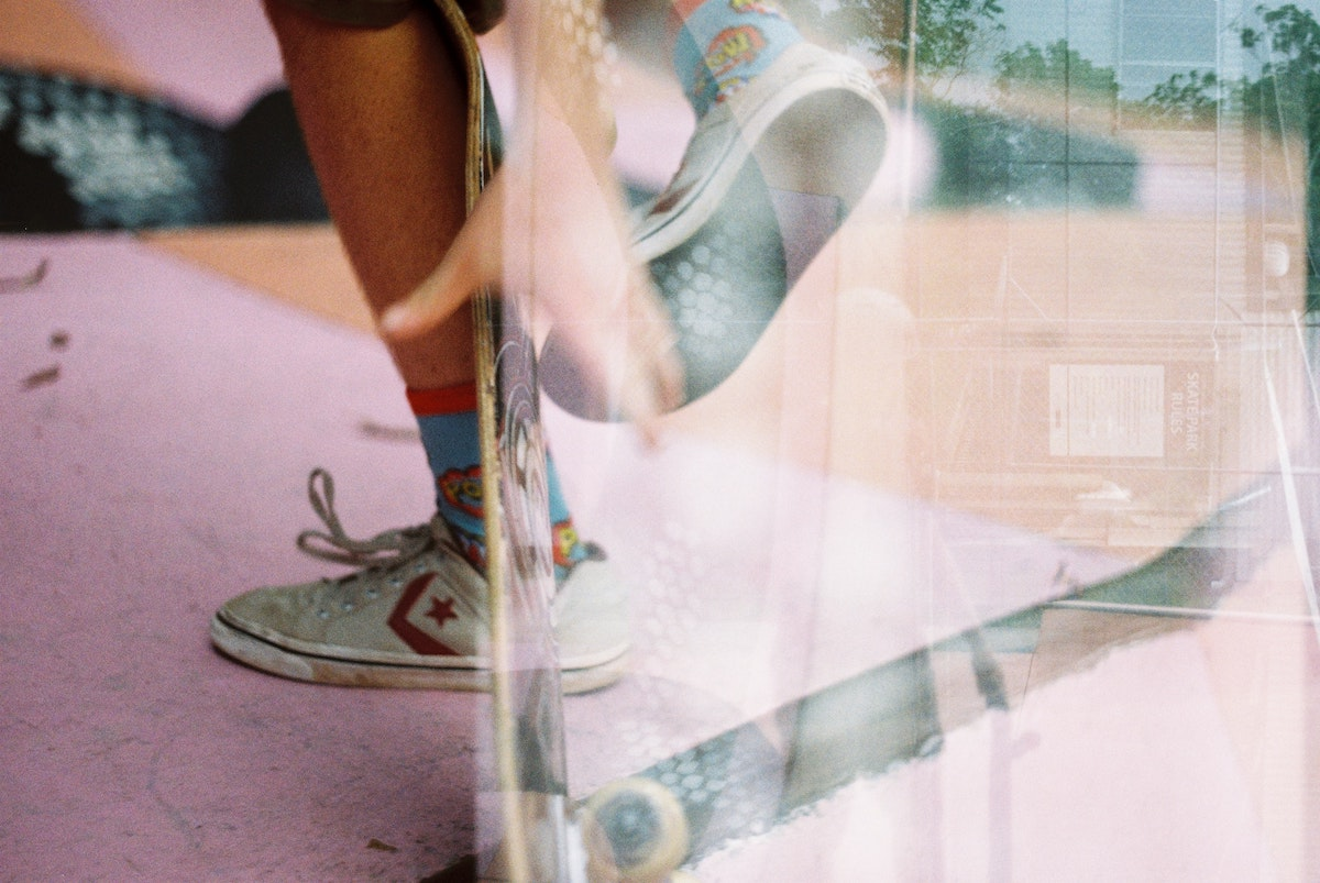 retro photo of legs and a skateboard