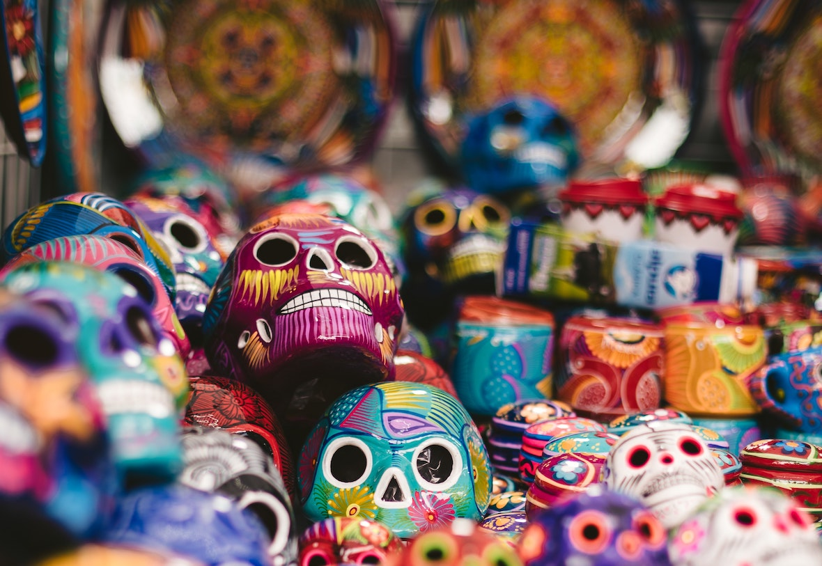 hand-painted mexican figure skulls show bright colours