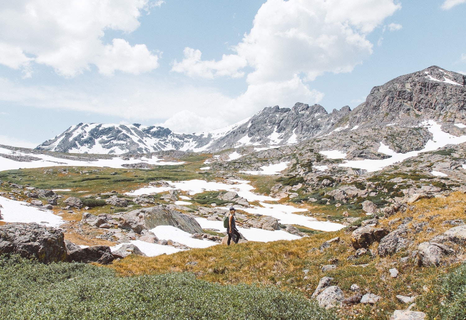 woman hiking in the snowy mountains of colorado