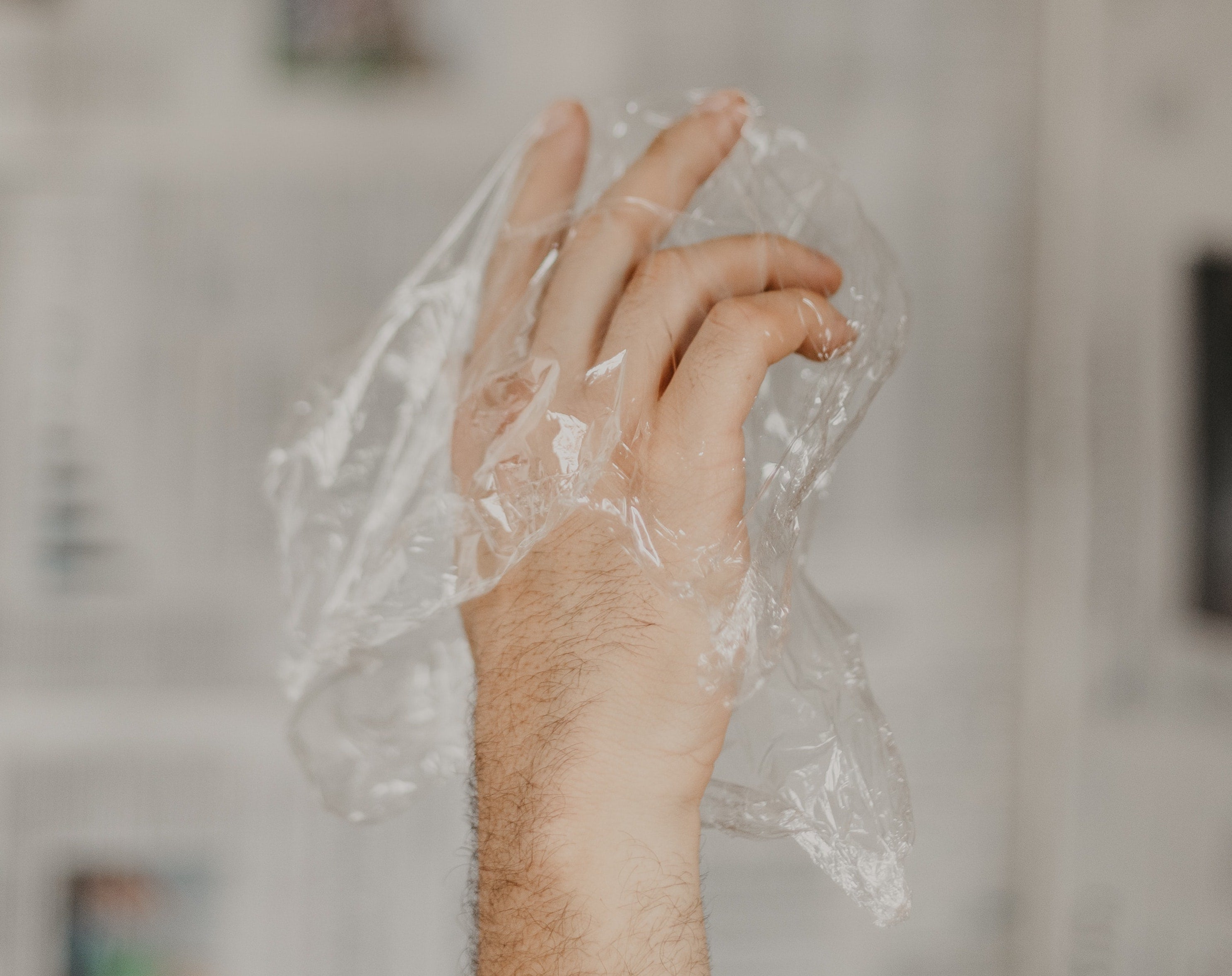 Dainty hand in a plastic bag