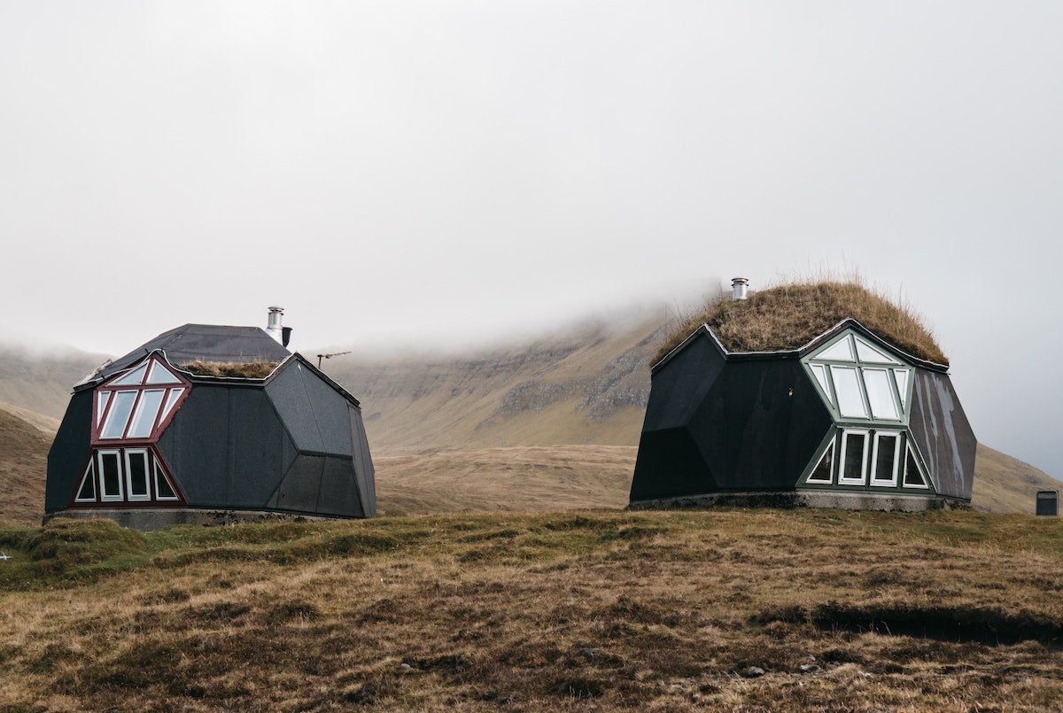 glamping huts in the fog