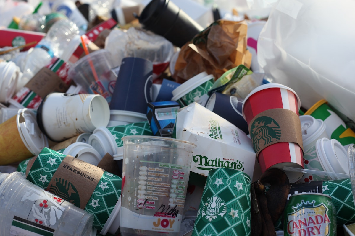 pile of plastic waste including to-go coffee cups