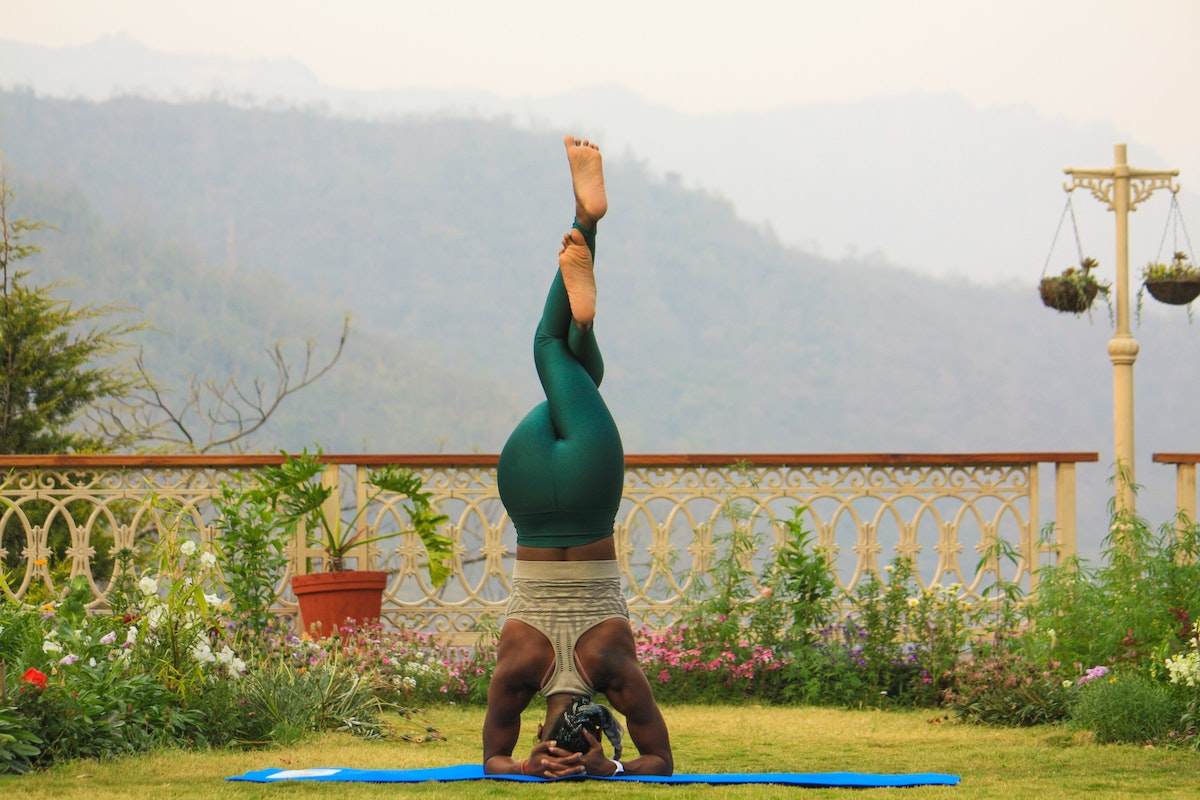 Woman in a headstand yoga posture in India
