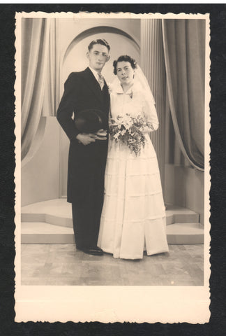 A black and white picture of a couple on their wedding day
