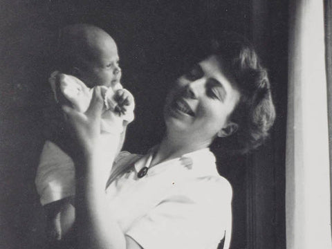 Black and white photo of smiling mother and baby
