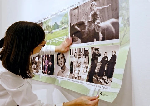Picture of a woman rolling out a wall collage