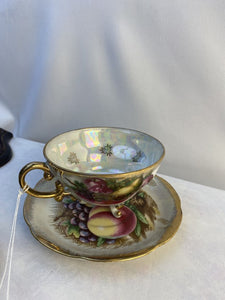 Coffee cup and saucer hand painted