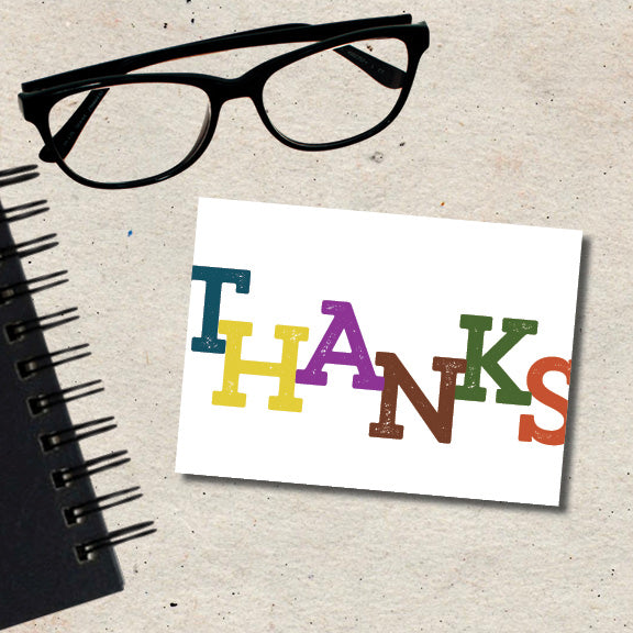 colorful note of thanks on the front of this folded note card that is blank inside and comes with a blank envelope.