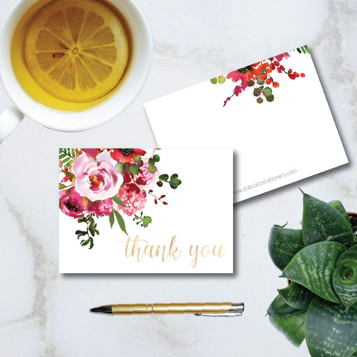 Bright pink watercolor floral motif with calligraphy thank you message on the front of a folded 4-bar note card.