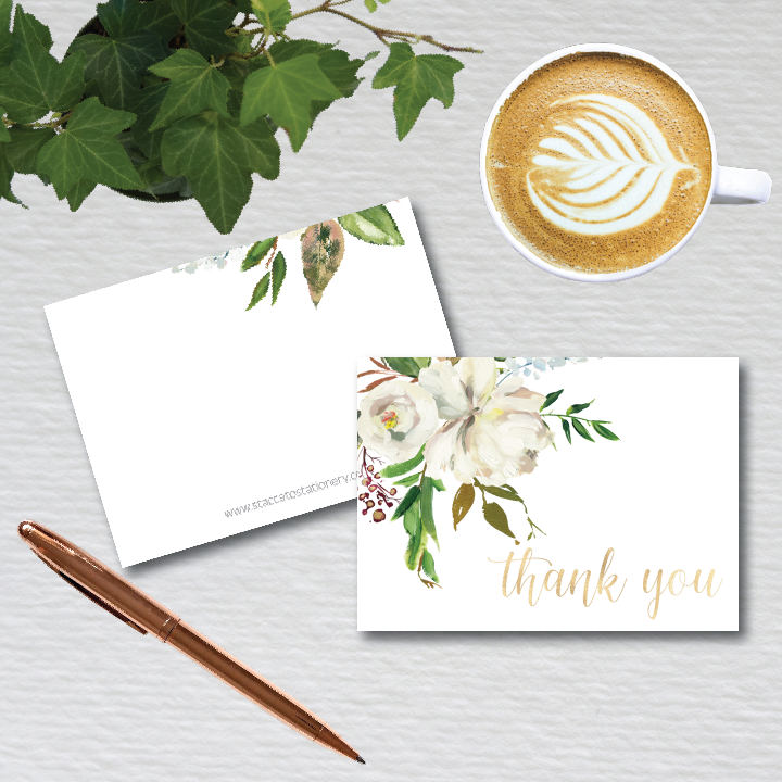 Watercolor floral artwork with varied greenery is beautifully asymmetric on this lovely 4-bar folded thank you note card.