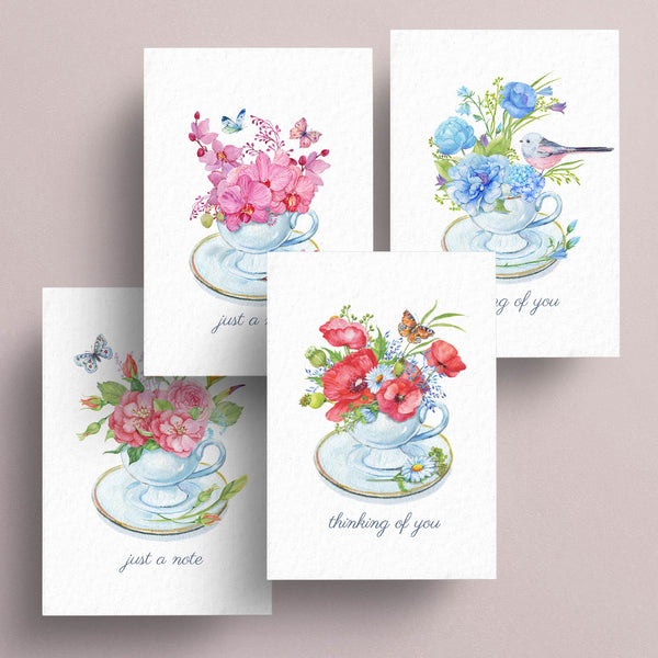 "All occasion assortment of notecards feature floral arrangements in teacups.  Some have birds and butterflies help accent the messages of ""thinking of you"" and ""just a note"".  Notecards are blank inside.  Assortment of 4."