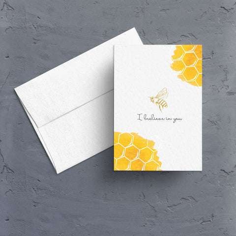 "Golden honeycomb dress the corners of this cute note card that features a gold foil bee in the center and the phrase ""I beelieve in you"".  Note card is blank inside.  Perfect note to send when someone needs a little motivation or inspiration."
