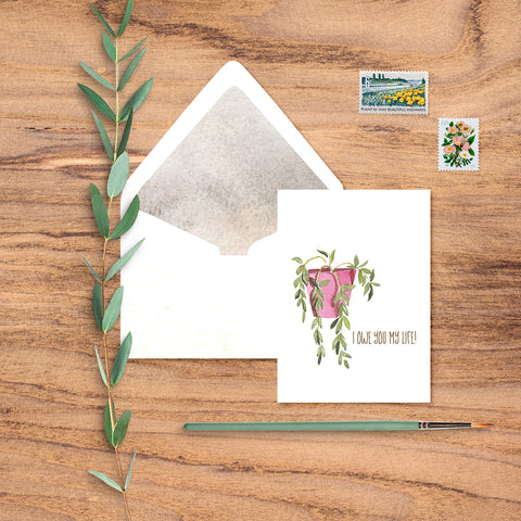 "Fun notecard says ""I owe you my life!"" and features a watercolor houseplant and pretty lined white envelope."