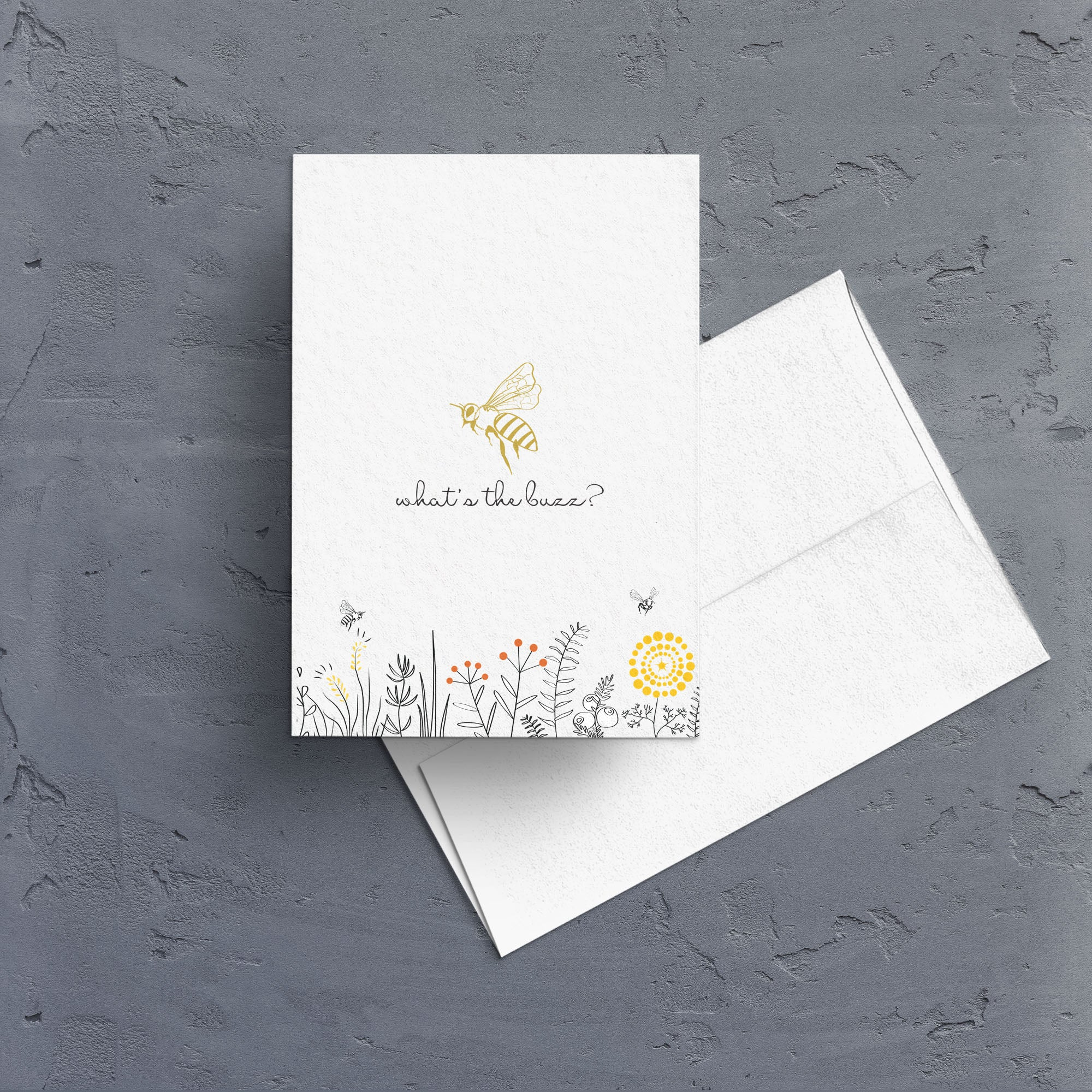 "A gold foil bee floats above a field of wildflowers.  The caption ""what's the buzz?"" makes this the perfect all-occasion note card.  Notecards are blank inside."