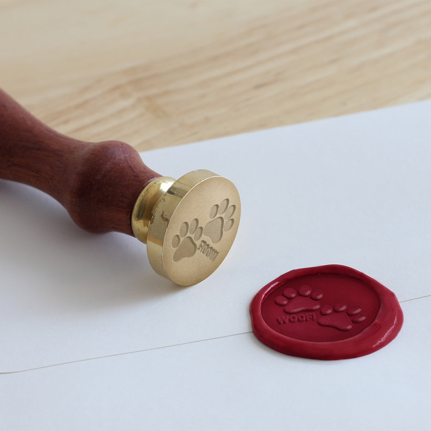 "A pair of paw prints and the greeting ""woof!"" is the perfect way to seal your next envelope."