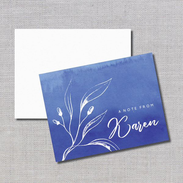 Pretty watercolor wash in choice of royal blue, wine, or emerald green are accented with white leaf and personalization.  Notecards are blank inside.