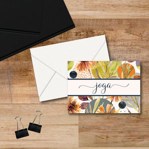Personalized note cards feature a beautiful calligraphy script in all lowercase for a name across the middle of a beautiful abstract autumn color floral pattern.  Cards are blank inside.