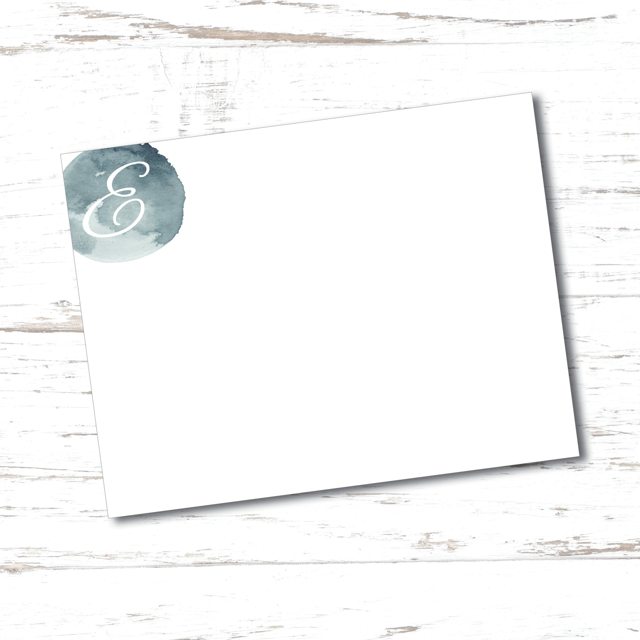 Simple and elegant personalized note cards feature a watercolor paint splotch in the upper left corner with a single initial monogram.  Flat notecards are perfect for quick thank you notes and professional correspondence.