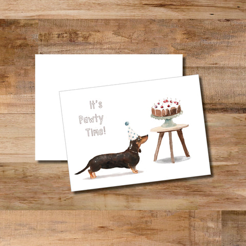 """It's Pawty Time"" declares the slightly too short dog with his nose on the birthday cake on this folded notecard with blank envelope."
