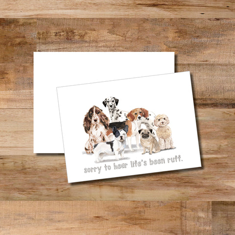 "Watercolored dogs on the front of the folded notecard state ""sorry life's been ruff"", notecard comes with blank envelope."
