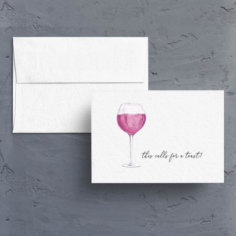 "Simple watercolor glass of red wine with the caption, ""this calls for a toast"" is a great celebratory note card.  Notecards are blank inside."