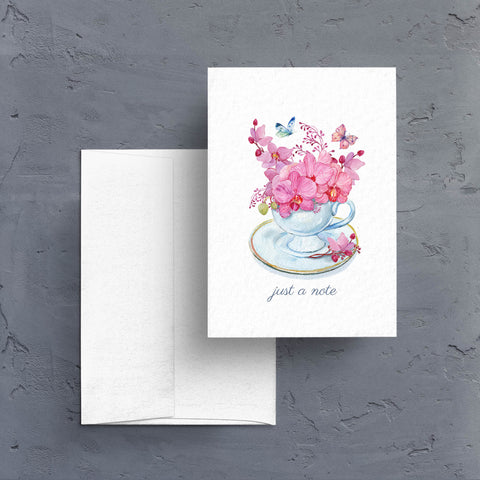 "Send ""just a note"" with a pretty little card featuring pink orchids and pretty butterflies.  Notecards are blank inside."