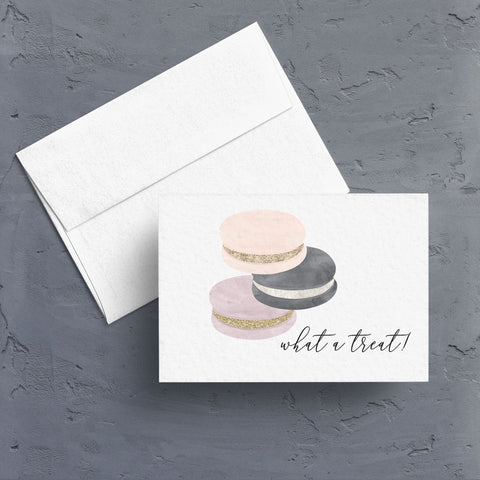 "Three colorful watercolor French macarons are stacked near the caption, ""what a treat"".  Its a lovely way to say thank you or acknowledge a special accomplishment.  Notecards are blank inside."