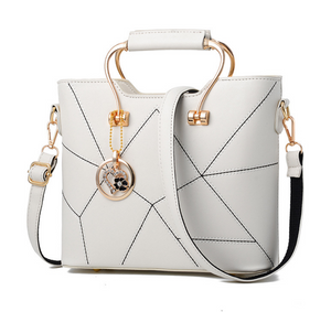 Geometric Patterned PU Leather Handbag with Heart Pendant - Available in Multiple Colours