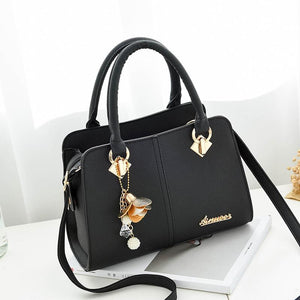 PU Leather Handbag with Flower Pendant - Available in Multiple Colours