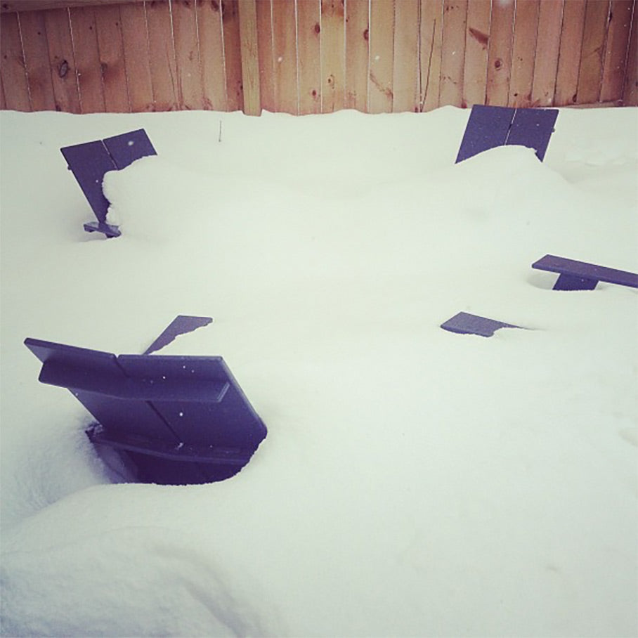 Loll chairs in circle buried in snow