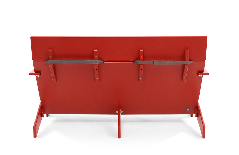 back of red lollygagger outdoor sofa with cushion strapped on