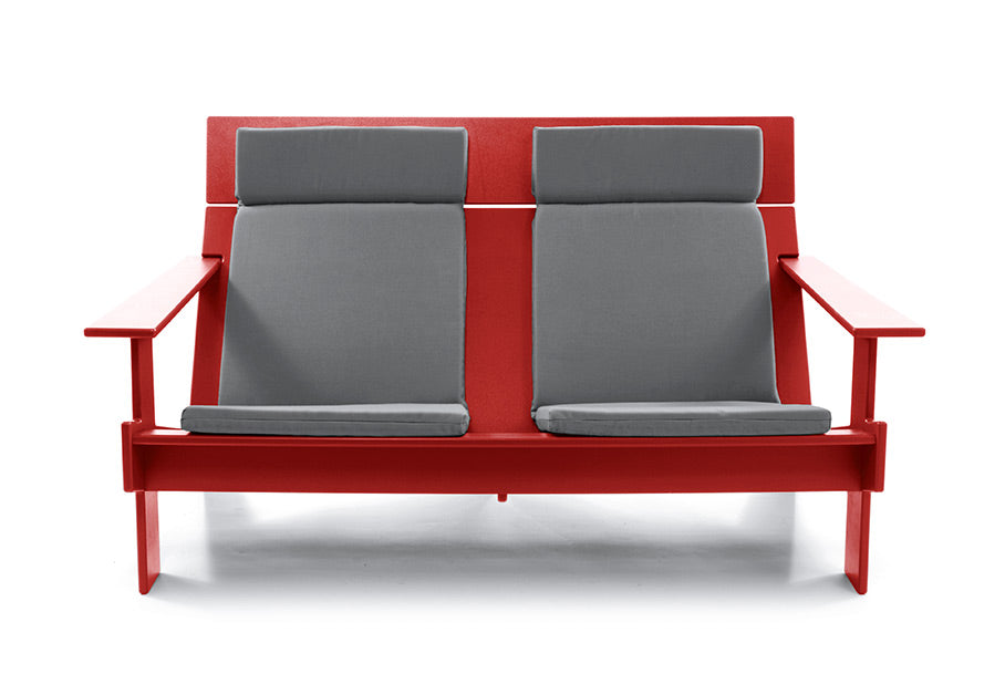 Red Lollygagger outdoor sofa with cushions